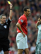 Rio Ferdinand gets a yellow card from Referee Alan Wiley during the Barclays Premier League match between Manchester United and Liverpool at Old Trafford on March 14, 2009 in Manchester, England.