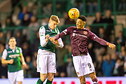 Vykintas Slivka (#8) of Hibernian FC and Sean Clare (#9) of Heart of Midlothian contest a header during the Ladbrokes Scottish Premiership match between Hibernian FC and Heart of Midlothian FC at Easter Road Stadium, Edinburgh, Scotland on 29 December 2018.