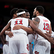 January 9, 2018, New York, NY : The St. John's men's basketball team huddles as they face off against the Hoyas at the Garden on Jan. 9. In something of a rematch of their 1985 contest, Basketball greats Patrick Ewing and Chris Mullin returned to Madison Square Garden on Tuesday night to face off as coaches with their respective Georgetown and St. John's teams.  CREDIT: Karsten Moran for The New York Times