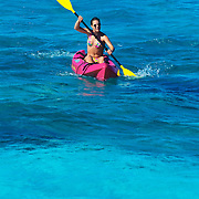 Woman kayaking in Chanka-naab reef,Cozumel.