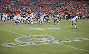 The NFL Divisional Playoff logo is painted on the playing field grass as the two teams line up for a play during the Denver Broncos NFL week 19 AFC Divisional Playoff football game against the Indianapolis Colts on Sunday, Jan. 11, 2015 in Denver. The Colts won the game 24-13. ©Paul Anthony Spinelli