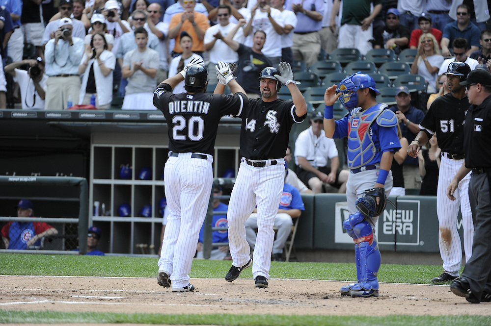 CHICAGO - JUNE 25:  Carlos Quentin #20 celebrates with Paul Konerko #14 of the Chicago White Sox after Quentin hit a three-run home run in the first inning off of Carlos Zambrano #38 of the Chicago Cubs on June 25, 2010 at U.S. Cellular Field in Chicago, Illinois.  The White Sox defeated the Cubs 6-0.  (Photo by Ron Vesely)