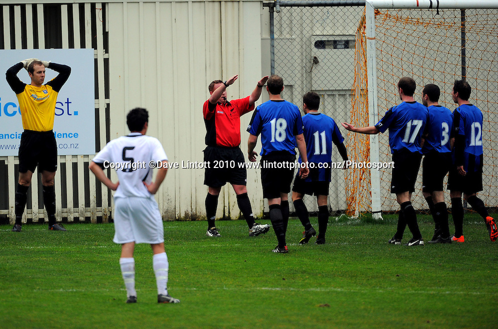 Referee Antony Riley waves Miramar players away after red-carding Keeper Phil Imray. Chatham Cup football - Miramar Rangers v East Coast Bays at David Farrington Park, Wellington on Sunday, 15 August 2010. Photo: Dave Lintott/Photosport