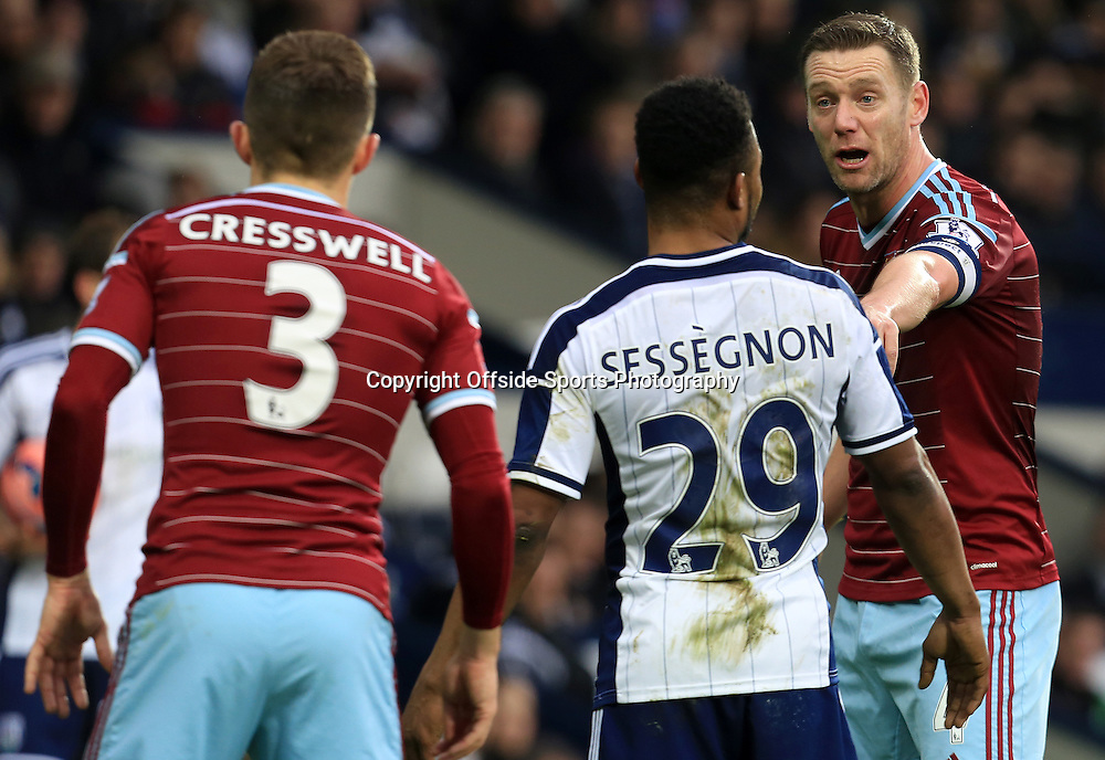 14th February 2015 - FA Cup 5th Round - West Bromwich Albion v West Ham United - Kevin Nolan of West Ham United tells team mate Aaron Cresswell to watch Stephane Sessegon of West Bromwich Albion - Photo: Paul Roberts / Offside.