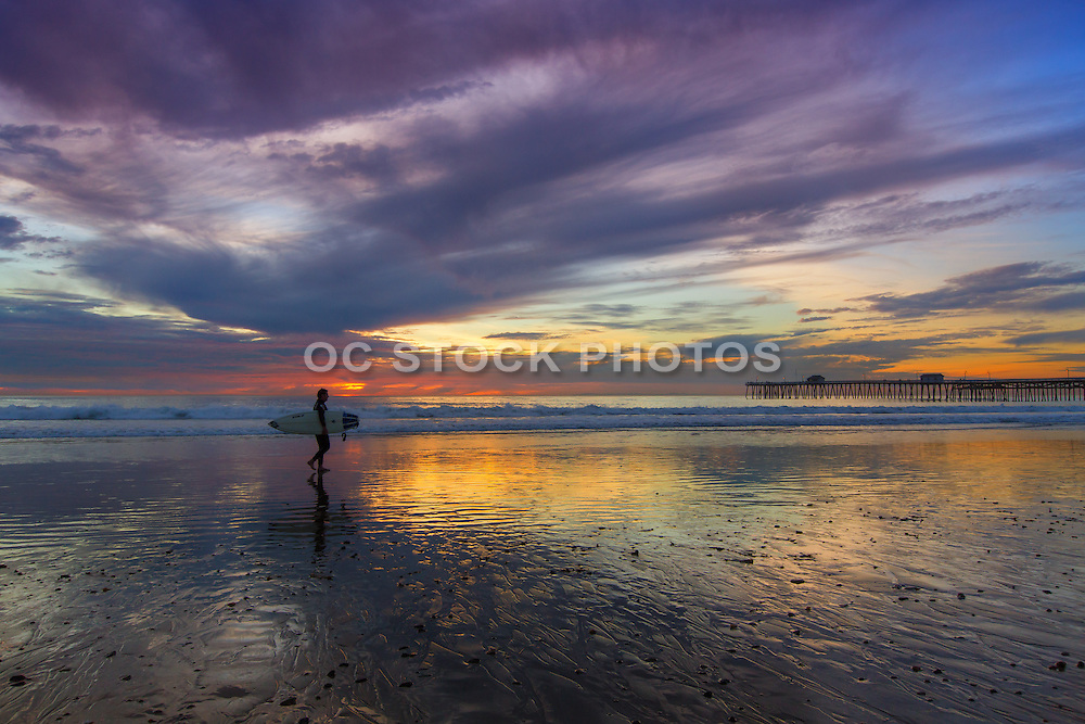 Surfer on the Beach at Low Tide in San Clemente