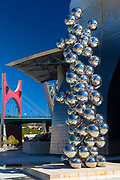 Bomba 1954 exhibit by Anish Kapoor of chrome balls with Red Arches behind by Guggenheim Museum at Bilbao, Basque country, Spain