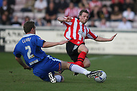 Photo: Pete Lorence.<br />Lincoln City v Stockport County. Coca Cola League 2. 07/04/2007.<br />Robert Clare and Peter Holmes slide in on the ball.
