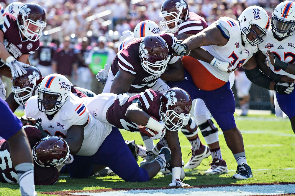 STARKVILLE, MS - SEPTEMBER 19:  Nick Gibson #21 of the Mississippi State Bulldogs rushes for a touchdown against the Northwestern State Demons at Davis Wade Stadium on September 19, 2015 in Starkville, Mississippi.  The Bulldogs defeated the Demons 62-13.  (Photo by Wesley Hitt/Getty Images) *** Local Caption *** Nick Gibson