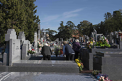 November 1, 2018 - Madrid, Spain - Flowers decorate a tomb at Almudena cemetery in Madrid, during  the November 1 celebrations for All Saint's day, a Catholic holiday where people visit cemeteries across the country to pay respects to deceased relatives. November 1, 2018 Madrid, Spain  (Credit Image: © Oscar Gonzalez/NurPhoto via ZUMA Press)
