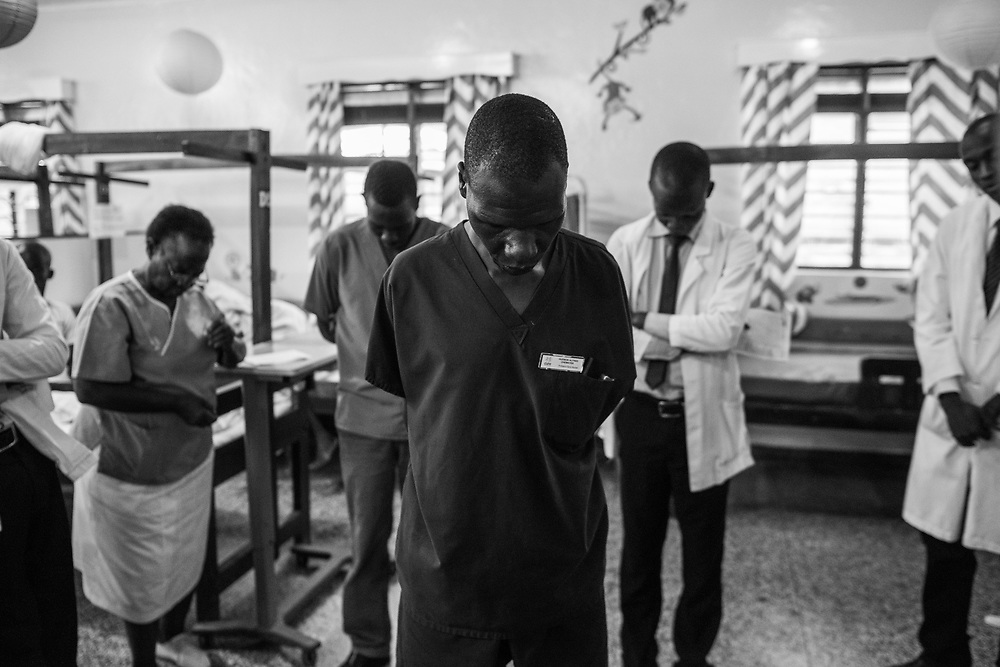 Hospital staff pray to start the day at Cure Hospital on February 6, 2017 in Mbale, Uganda. Sub-Saharan Africa has only one neurosurgeon for every 10 million people; in the United States and Britain, there is one surgeon for every 100,000 people.