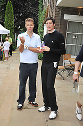 Left to right, presenters RICHARD BACON and VERNON KAY at the Mini Masters Golf tournament in aid of LEUKA - London's celebrity golf tournament held at Duke's Meadow Golf Club, Dan Mason Drive, London W4 on 17th July 2009.
