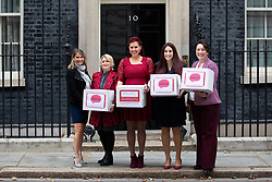 © Licensed to London News Pictures. 08/10/2018. London, UK. Natasha Devon MBE and Luciana Berger MP, (centre) and other supporters of the 'Where's Your Head At?' campaign deliver a petition to Downing Street, calling for a change in the law, to give mental health equal importance to physical health in the workplace. Photo credit : Tom Nicholson/LNP