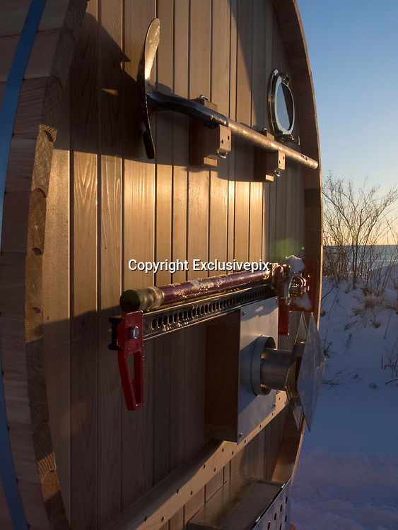 Beach break! The luxurious $16,400 Surf Sauna where surfers can warm up in style after a day on a snowy beach<br /> <br /> It's the answer to winter surfers' prayers - a sauna waiting for them at the edge of the water.<br /> After a day in bitterly cold waves, this new mobile concept is being billed as the perfect way to warm up and dry off away from snowy beaches.<br /> The flagship Surf Sauna, which took years to design and build, is now on sale in New Hampshire, US, for $16,400 (£9,800), and the company plans to create more to rent by the day for $190 (£115).<br /> <br /> Boasting temperatures that reach 90C, each Surf Sauna is bespoke and can accommodate from two to eight people, with options including a changing tent and shower, surf racks, and wood-fired stove. <br /> Ross Beane, Surf Sauna spokesman, said the company will have them in other locations soon, but currently serves North Eastern US.<br /> He added: 'Our aim with Surf Sauna is to create a warming place that builds community with cold weather surfers. <br /> <br /> 'The sauna is a crucial part of utilizing the entire day for winter surf sessions. The inside smells of rich cedar and is very cozy.<br /> 'We often bring music in the sauna and relax with friends. The sauna reaches up to 190F so even the coldest surfer can warm up inside quickly.<br /> 'The product is our original idea and after extensive research we found our product to be the only one of its kind with the surf sauna branding.'<br /> <br /> The Surf Sauna is made out of Western Red Cedar which is naturally rot resistant and antimicrobial.<br /> The chassis and hardware are produced from marine grade galvanised and stainless steel to hold up to years of salt water exposure.<br /> Every Surf Sauna comes bundled with a mounted shovel and hi-lift jack aimed at helping surfers get unstuck after pulling it to your favorite secret spot.<br /> ©Surf Sauna/Exclusivepix