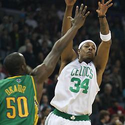 Feb 10, 2010; New Orleans, LA, USA; Boston Celtics forward Paul Pierce (34) passes the ball past New Orleans Hornets center Emeka Okafor (50) during the first quarter at the New Orleans Arena. Mandatory Credit: Derick E. Hingle-US PRESSWIRE