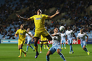 AFC Wimbledon striker Lyle Taylor (33) with backwards header during the EFL Sky Bet League 1 match between Coventry City and AFC Wimbledon at the Ricoh Arena, Coventry, England on 28 September 2016. Photo by Stuart Butcher.