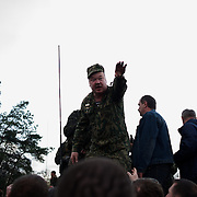 The commander of a column of Ukrainian men riding on armoured personnel carriers and tanks, blocked by pro-Russia activists in the eastern Ukrainian city of Kramatorsk, attempts to negotiate with the protestors a free passage for the convoy.