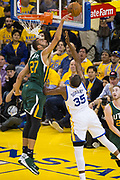 Utah Jazz center Rudy Gobert (27) blocks a lay up by Golden State Warriors forward Kevin Durant (35) during Game 1 of the Western Conference Semifinals at Oracle Arena in Oakland, Calif., on May 2, 2017. (Stan Olszewski/Special to S.F. Examiner)