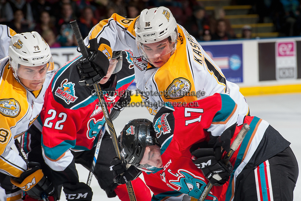 KELOWNA, CANADA - DECEMBER 3: Tanner Kaspick #16 of the Brandon Wheat Kings digs for the puck after the face off against Rodney Southam #17 of the Kelowna Rockets during first period on December 3, 2016 at Prospera Place in Kelowna, British Columbia, Canada.  (Photo by Marissa Baecker/Shoot the Breeze)  *** Local Caption ***