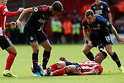 Callum Robinson of Sheffield United challenges Andros Townsend of Crystal Palace during the Premier League match between Sheffield United and Crystal Palace at Bramall Lane, Sheffield, England on 18 August 2019.