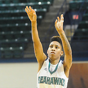 UNCW's Kelva Atkins shoots against Towson Sunday January 25, 2015 at Trask Coliseum. (Jason A. Frizzelle)