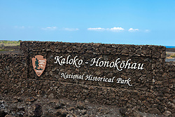 Entrance sign made of lava rock, Kaloko-Honokohau National Historical Park, The Big Island, Hawaii, United States of America