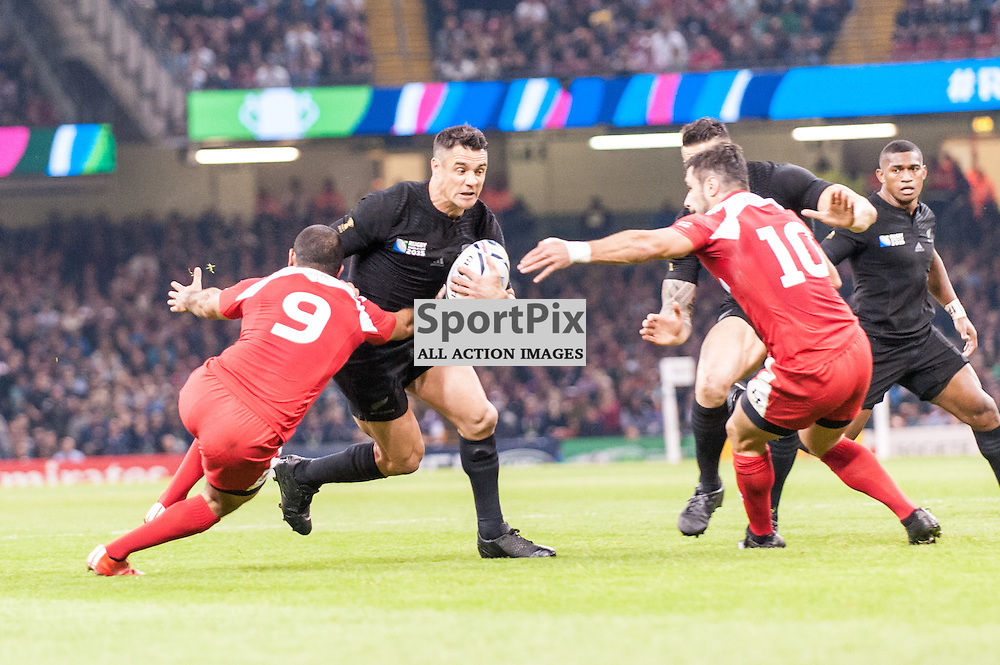 All Black Dan Carter bursts between Giorgi Begadze of Georgia and Lasha Malaguradze of Georgia. Action from the New Zealand v Georgia game in Pool C of the 2015 Rugby World Cup at Milennium Stadium in Cardiff, 2 October 2015. (c) Paul J Roberts / Sportpix.org.uk