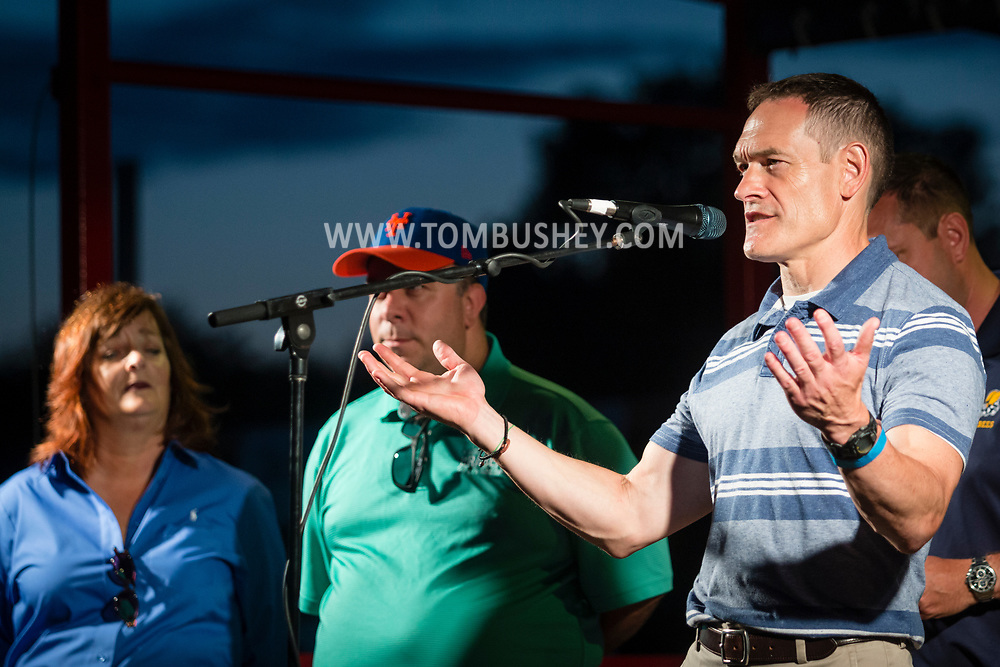 Hamptonburgh, New York - Orange County Veterans Service Agency director Christian Farrell speaks to the crowd before the 2017 Freedom Fest fireworks show at Thomas Bull Memorial Park on July 15, 2017. The event featured music followed by fireworks.