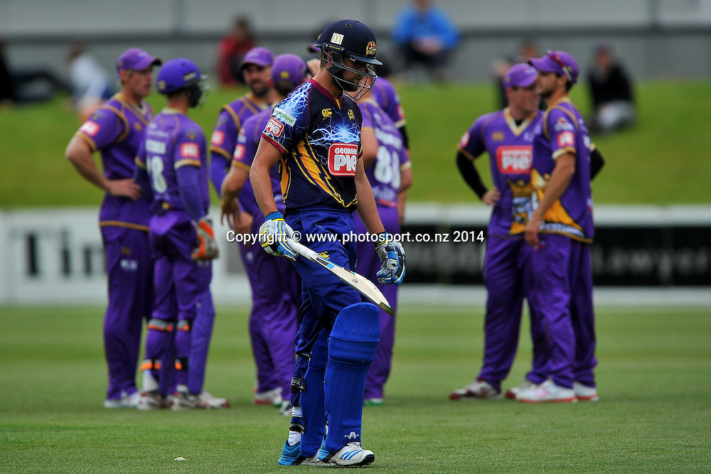 Sam Wells of the Otago Volts walks off the field after being dismissed, during the Georgie Pie Twenty20 match between the Otago Volts and the Canterbury Kings, held at the University Oval, Dunedin, New Zealand, 20 November 2014. Credit: Joe Allison / www.photosport.co.nz