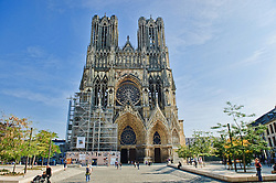 Street view of front fascade of the catherdral...Notre-Dame de Reims (Our Lady of Rheims) is the Roman Catholic cathedral of Reims France...Notre-Dame de Reims cathedral, the former Abbey of Saint-Remi, and the Palace of Tau were added to the list of UNESCO World Heritage Sites in 1991.