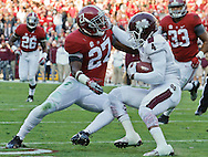 Nov 15, 2014; Tuscaloosa, AL, USA; Alabama Crimson Tide defensive back Nick Perry (27) grabs Mississippi State Bulldogs wide receiver Jameon Lewis (4) <br /> at Bryant-Denny Stadium. Mandatory Credit: Marvin Gentry