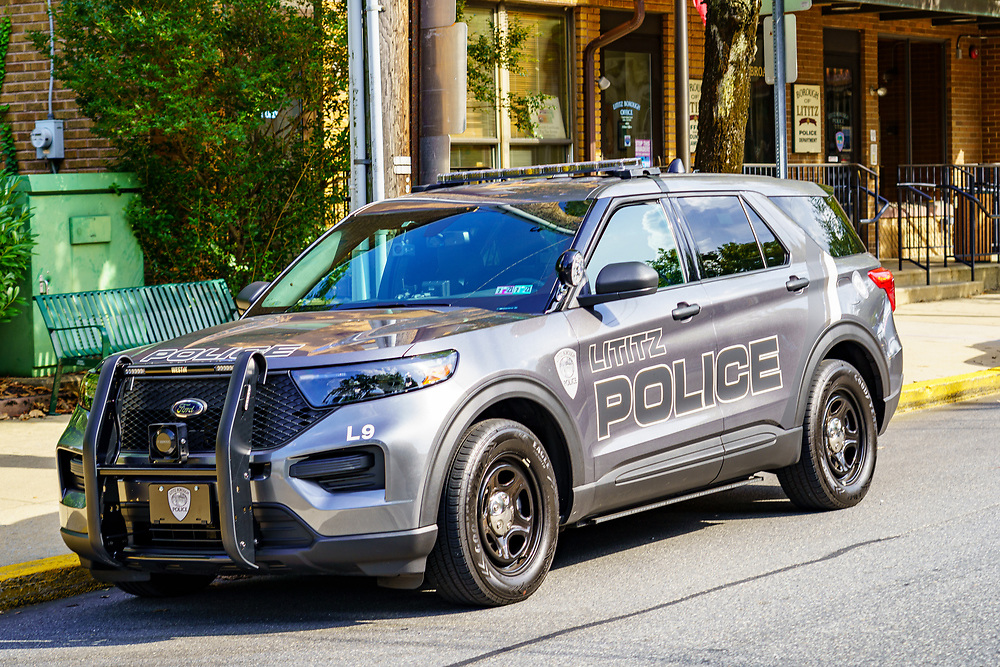 Lititz, PA, USA - August 21, 2020: A Lititz Police Department marked police cruiser parked in the downtown area of the borough.