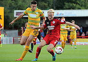 Christian Scales protects the ball from Harry Cornick during the Sky Bet League 2 match between Crawley Town and Yeovil Town at the Checkatrade.com Stadium, Crawley, England on 19 September 2015. Photo by Michael Hulf.