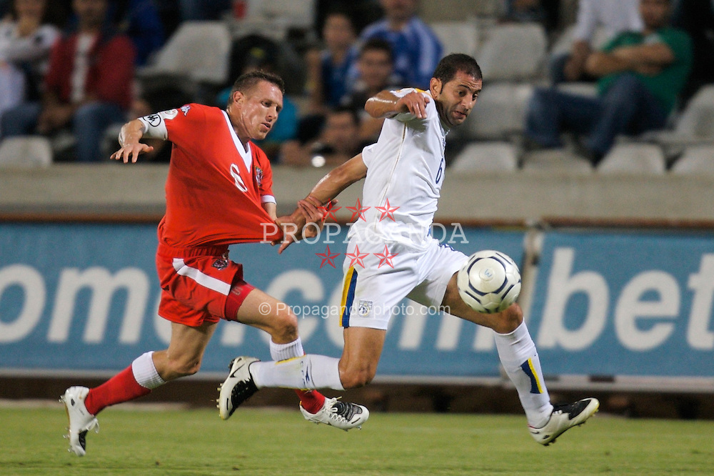Nicosia, Cyprus - Saturday, October 13, 2007: Wales' captain Craig Bellamy and Cyprus' Stelios Okkarides during the Group D UEFA Euro 2008 Qualifying match at the New GSP Stadium in Nicosia. (Photo by David Rawcliffe/Propaganda)
