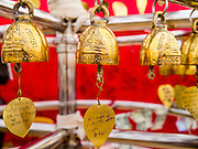 "27 NOVEMBER 2012 - BANGKOK, THAILAND:  Prayer bells inscribed ""Golden Mount Thailand"" at the Wat Saket Temple Fair in Bangkok. Wat Saket, popularly known as the Golden Mount or ""Phu Khao Thong,"" is one of the most popular and oldest Buddhist temples in Bangkok. It dates to the Ayutthaya period (roughly 1350-1767 AD) and was renovated extensively when the Siamese fled Ayutthaya and established their new capitol in Bangkok. The temple holds an annual fair in November, the week of the full moon. It's one of the most popular temple fairs in Bangkok. The fair draws people from across Bangkok and spills out in the streets around the temple.   PHOTO BY JACK KURTZ"