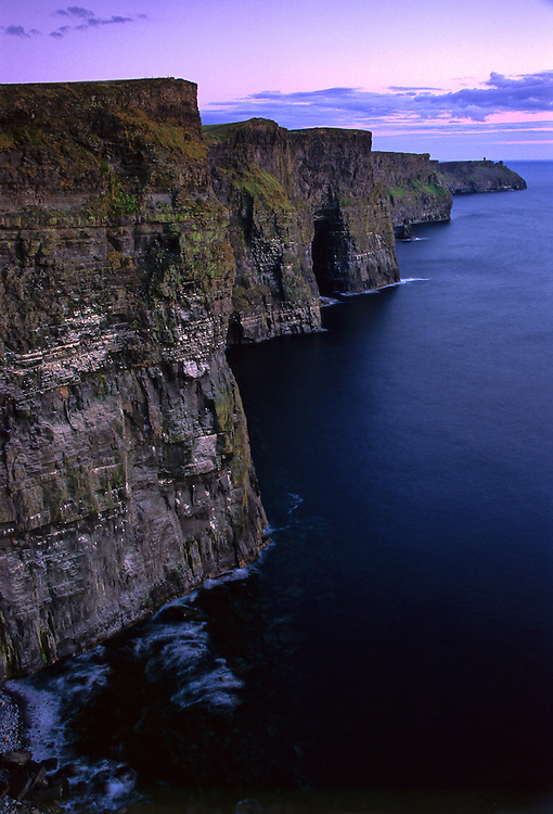 After sunset, an eerie light shines over the Cliffs of Moher, which are one of the highest seaside cliffs on the Western Coasr of Ireland