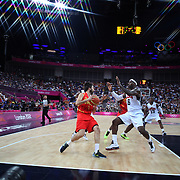 Lebron James, USA,  defends against Juan-Carlos  Navarro, Spain, in action during the Men's Basketball Final between USA and Spain at the North Greenwich Arena during the London 2012 Olympic games. London, UK. 12th August 2012. Photo Tim Clayton