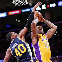 11 February 2014: Los Angeles Lakers power forward Jordan Hill (27) goes for the layup against Utah Jazz small forward Jeremy Evans (40) during the Utah Jazz 96-79 victory over the Los Angeles Lakers at the Staples Center, Los Angeles, California, USA.