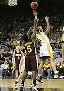 25 JANUARY 2007: Iowa forward Krista VandeVenter (51) puts up a shot in front of Minnesota guard Korinne Campbell (5) in Iowa's 80-78 overtime loss to Minnesota at Carver-Hawkeye Arena in Iowa City, Iowa on January 25, 2007.
