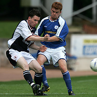 St Johnstone v Raith Rovers...28.08.04<br />John Boyle is tackled by Stevie McManus<br /><br />Picture by Graeme Hart.<br />Copyright Perthshire Picture Agency<br />Tel: 01738 623350  Mobile: 07990 594431