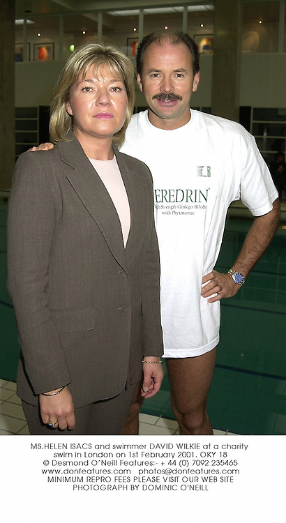 MS.HELEN ISACS and swimmer DAVID WILKIE at a charity swim in London on 1st February 2001.	OKY 18