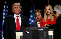 Republican presidential nominee Donald Trump talks to convention staff with daughter Ivanka (R) during Trump's walk through at the Republican National Convention in Cleveland July 21, 2016.  REUTERS/Rick Wilking