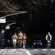 NYTRUN - NOV. 6, 2016 - NEW YORK - Gwen Jorgensen, center, who won the gold medal in the triathlon at the Rio Olympics, runs south along 5th Avenue, just north of E 90th Street, as she competes in the 2016 TCS New York City Marathon on Sunday. She finished in 2:41:01. NYTCREDIT:  Karsten Moran for The New York Times **PLS CHECK FINISH PLACE AND TIMES