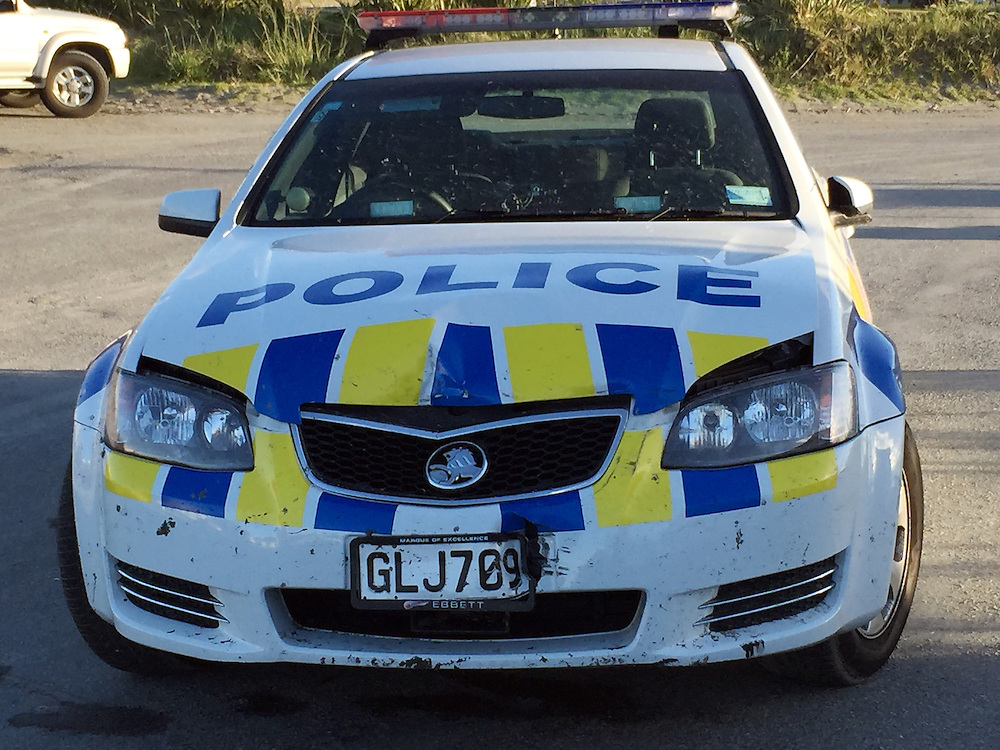 A car chase that started on SH1 ended with the police stopping the ute with spikes on Paraparaumu Beach but not before it had rammed a Police car, Paraparaumu, New Zealand, Friday, October 24, 2014. Credit:SNPA / Stephen Hobbs   **BEST AVAILABLE QUALITY**