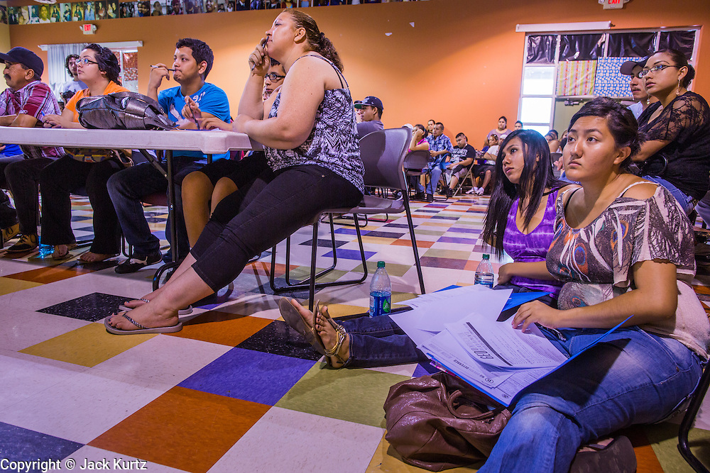"18 AUGUST 2012 - PHOENIX, AZ:  Young people who hope to be granted ""deferred action"" listen to speakers at a deferred action workshop in Phoenix. More than 1000 people attended a series of 90 minute workshops in Phoenix Saturday on the ""deferred action"" announced by President Obama in June. Under the plan, young people brought to the US without papers, would under certain circumstances, not be subject to deportation. The plan mirrors some aspects the DREAM Act (acronym for Development, Relief, and Education for Alien Minors), that immigration advocates have sought for years. The workshops were sponsored by No DREAM Deferred Coalition.  PHOTO BY JACK KURTZ"