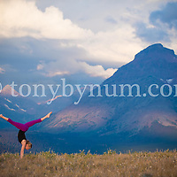dramatic nature yoga on ridge in mountains
