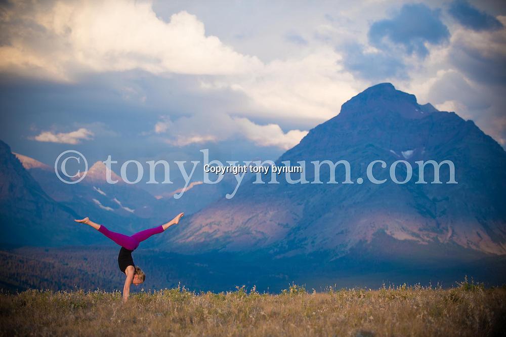 dramatic nature yoga on ridge in mountains