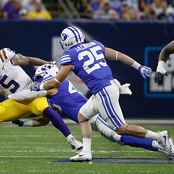 Sep 2, 2017; New Orleans, LA, USA; LSU Tigers running back Derrius Guice (5) is tackled by Brigham Young Cougars defensive lineman Rhett Sandlin (46) during the second quarter of the AdvoCare Texas Kickoff game at the Mercedes-Benz Superdome. Mandatory Credit: Derick E. Hingle-USA TODAY Sports