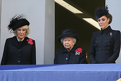 © Licensed to London News Pictures. 10/11/2019. London, UK. Camilla, Duchess of Cornwall (L), Queen Elizabeth II  and Catherine, Duchess of Cambridge attend the Remembrance Sunday ceremony at the Cenotaph memorial in Whitehall, central London. Remembrance Sunday is held each year to commemorate the service men and women who fought in past military conflicts. Photo credit: Dinendra Haria/LNP