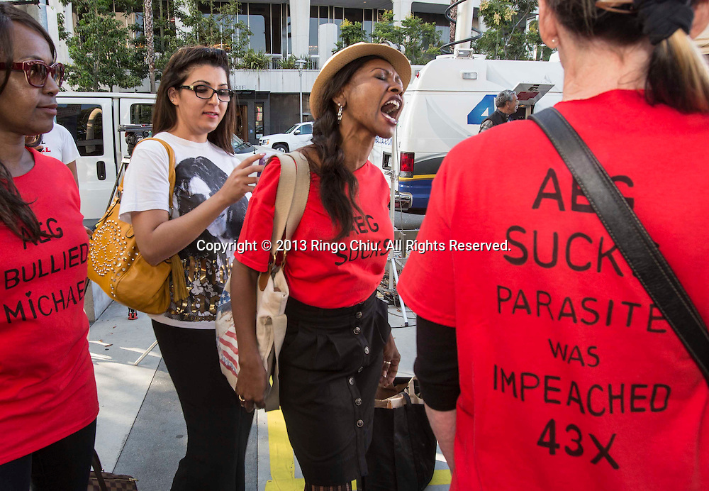 Michael Jackson fans yell outside outside a courthouse on Wednesday, October 2, 2013, in Los Angeles, California.  A jury cleared AEG Live of negligence in a case that attempted to link the death of Michael Jackson to the company that promoted his ill-fated comeback shows. (Photo by Ringo Chiu/PHOTOFORMULA.com)
