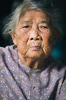 A portrait of Ha Thi Qui, a survivor of the My Lai Massacre during the American-Vietnam War, at her home in central Vietnam.